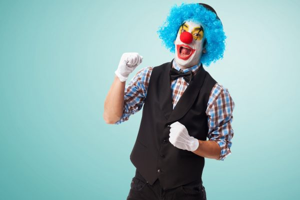 portrait of a clown smiling over white background